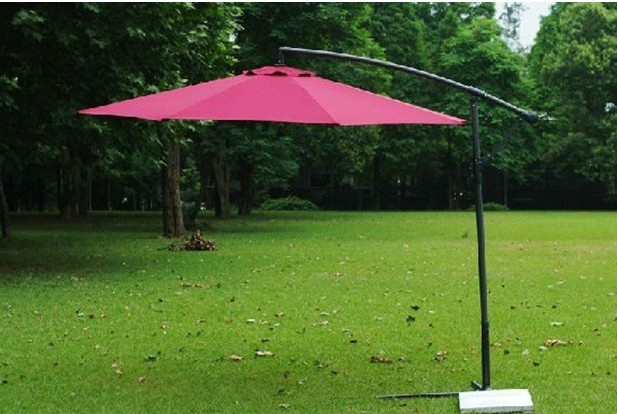 Outdoor patio umbrella with base