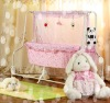 Versatile electric baby crib with sound control & wet-alarming function